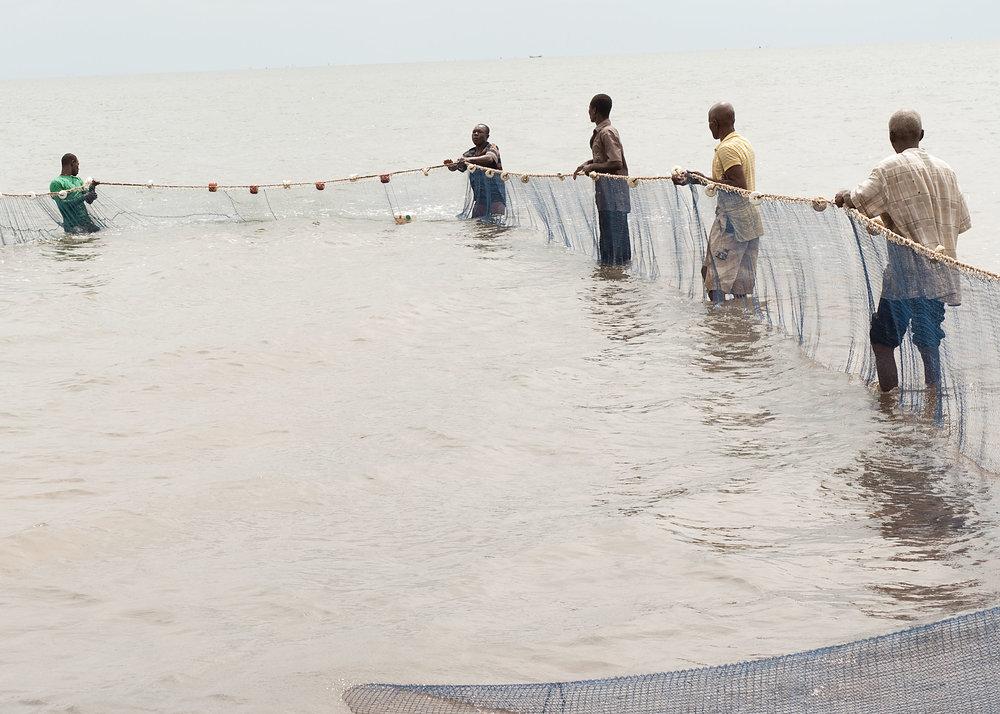 village fishermen pulling in nets