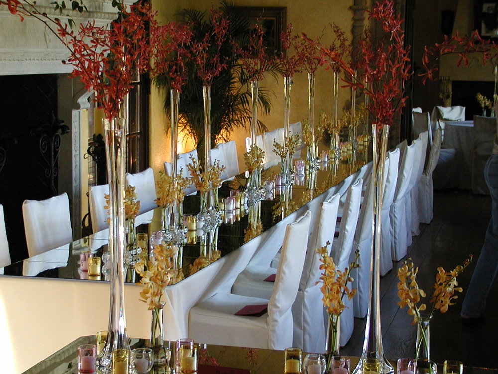 mirrored table with monobotanical vases.JPG