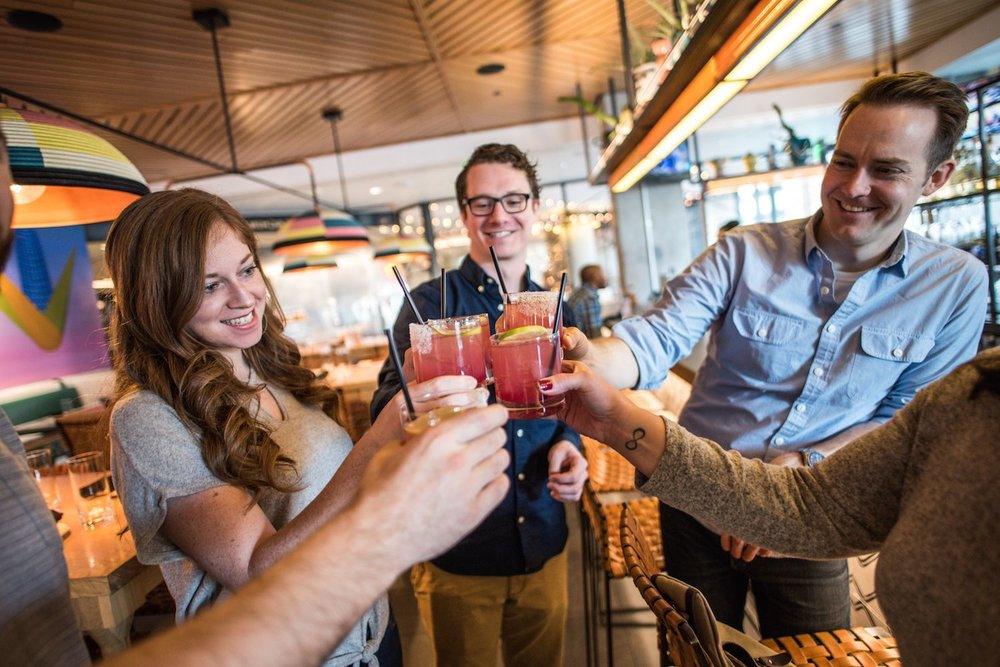 Three guests cheers with margaritas at Kachina on the Denver food tour