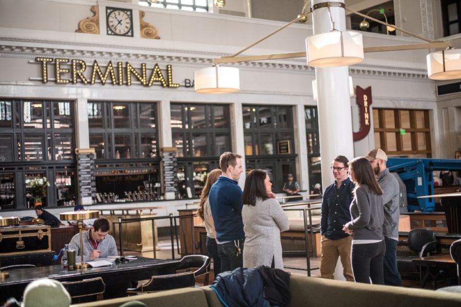 Group of people talking inside Denver's Union Station