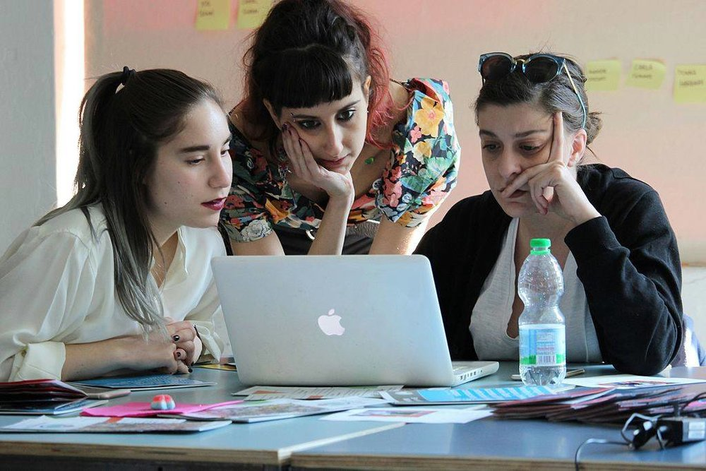 Women at a Wikipedia edit-a-thon, making sure women's stories are reflected (photo by Francesca Lissoni)