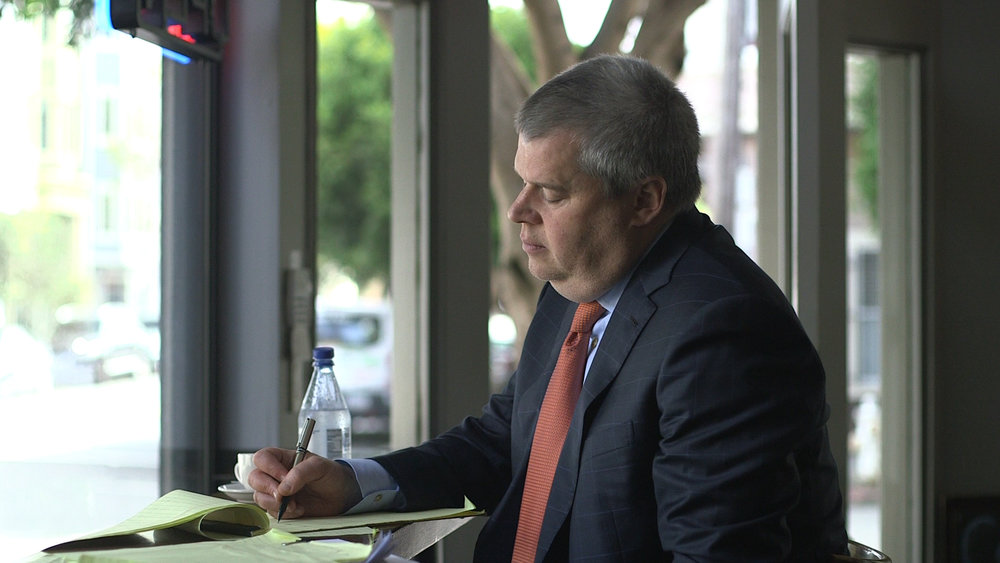 Daniel Handler writing by hand as part of his process.jpg