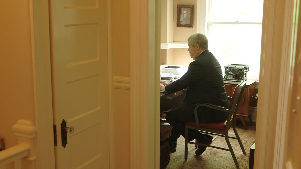 Daniel Handler typing at his desk.jpg
