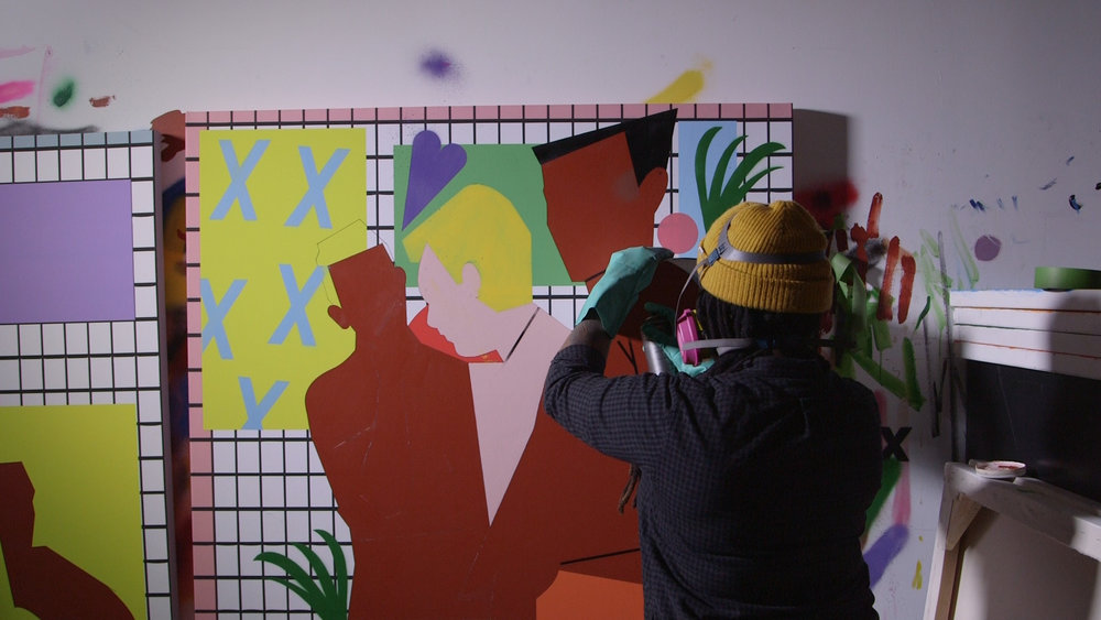 Nina chanel abney working on art in her studio.jpg