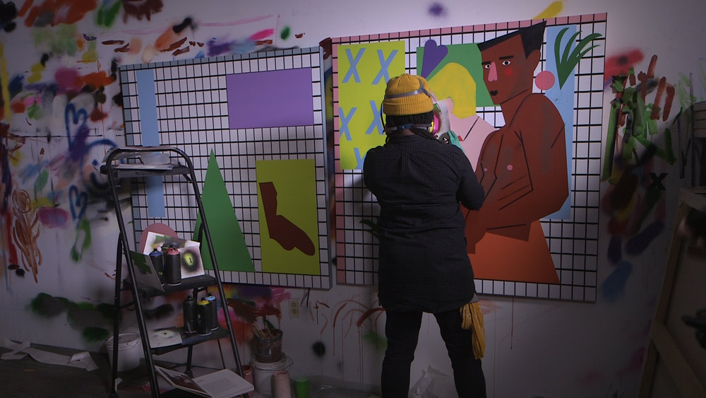 Nina Chanel Abney working on a painting in her studio.jpg