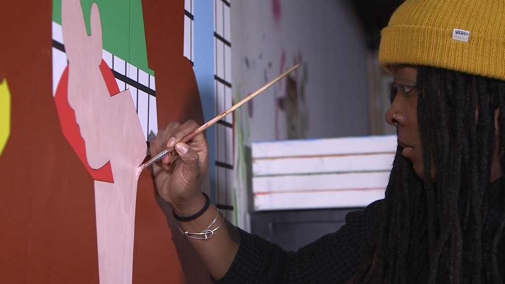 Nina chanel Abney painting in her studio.jpg