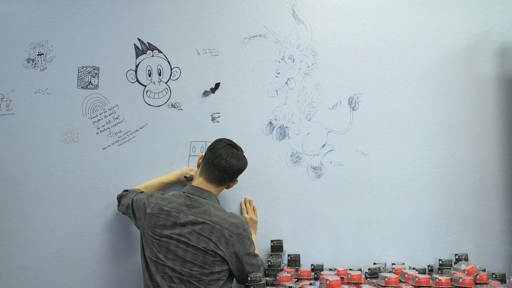 Gene Yang putting the Writing on the Walls.jpg