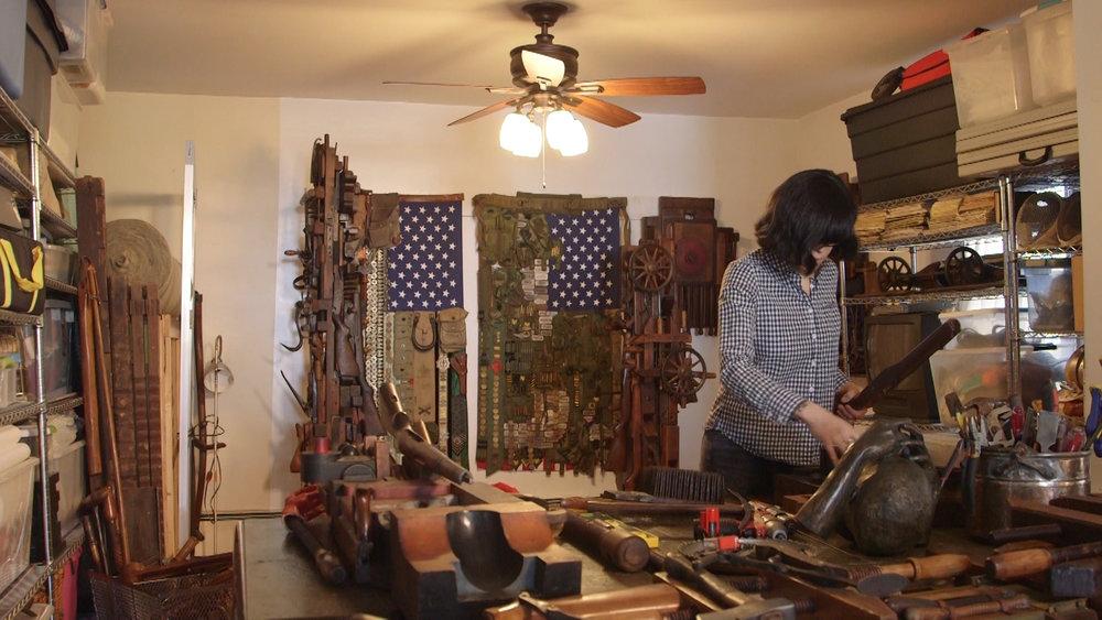Sara Rahbar working in her gallery.jpg