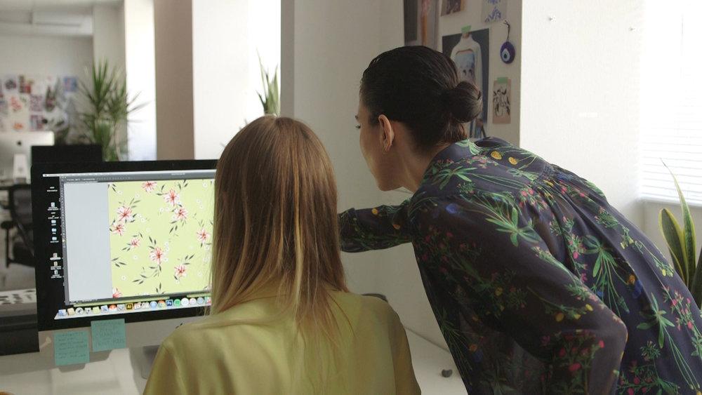 Liz Casella working with an employee in her office in LA.jpg