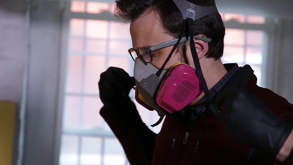 Greg Dunn wearing paint mask.jpg