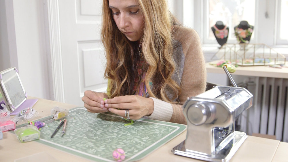 Veruschka Stevens working on her jewelry.jpg
