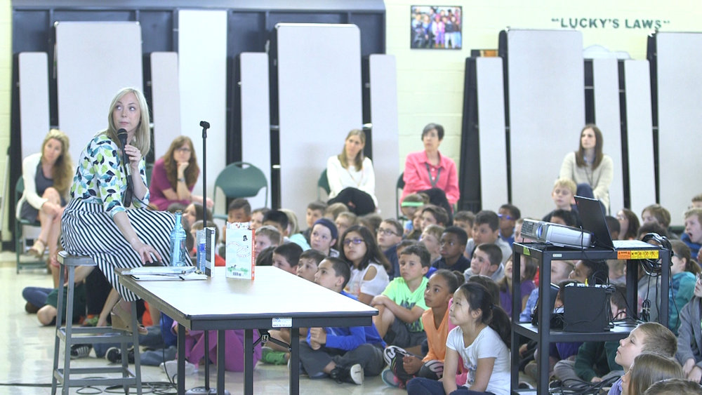 Michelle Cuevas reading for young fans in PA.jpg