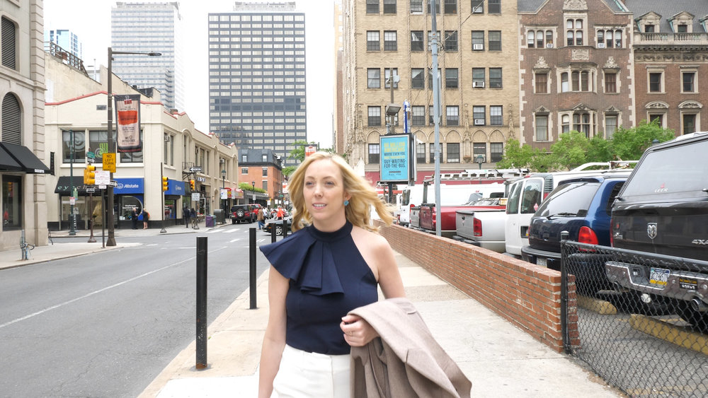 Michelle Cuevas walking down the street in Philadelphia.jpg