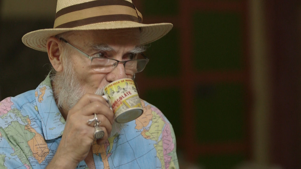 Antonio Martorell drinking out of a tiny cup.jpg