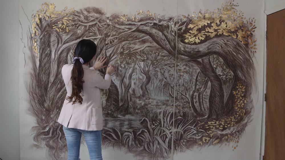 RIP Romance Jessica Libor working on a large piece of art.jpg