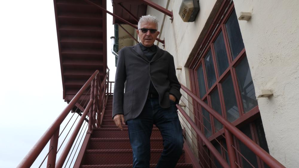 Bill+Fontana+climbing+down+some+stairs.png