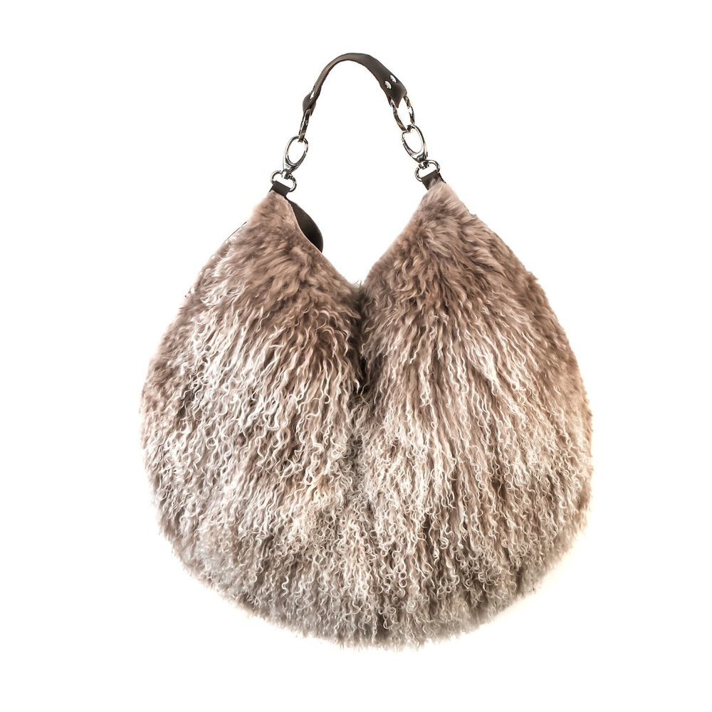 if my credit card hadn't been declined, i would now own this tibetan wool bag by    stephanie wheat   . probably for the best. cool looking but really expensive