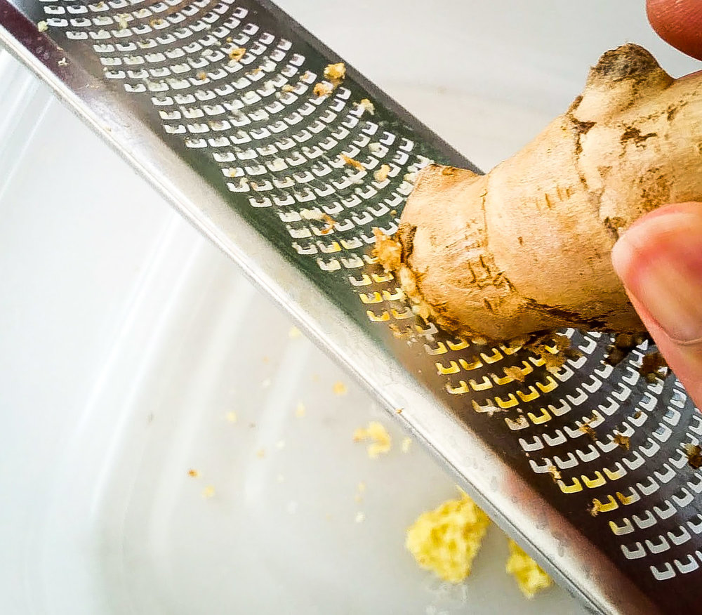TIP: Grating fresh ginger directly over the pot or bowl that it will eventually be added to will capture more flavor and essence from the ginger. Also, skip peeling ginger because the microplane will retain most of the skin when grating.