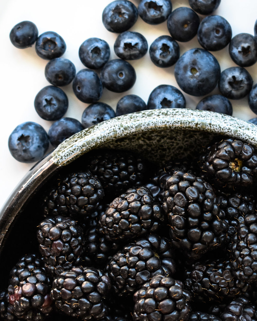 Fresh blackberries and blueberries.