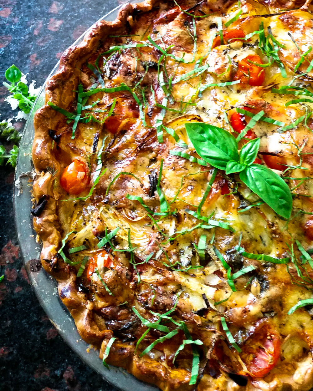 Summer Tomato and Herb Pie with peak-of-the-season tomatoes, fresh herbs and a golden crust.