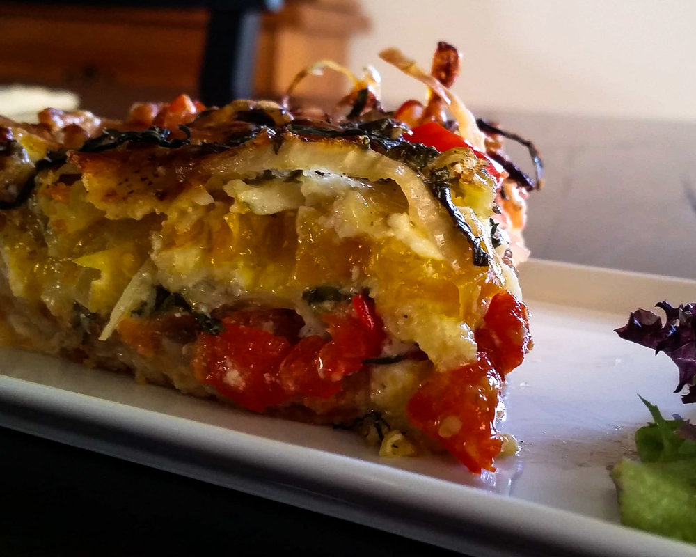 Layers of tomato, melted cheese and onion.