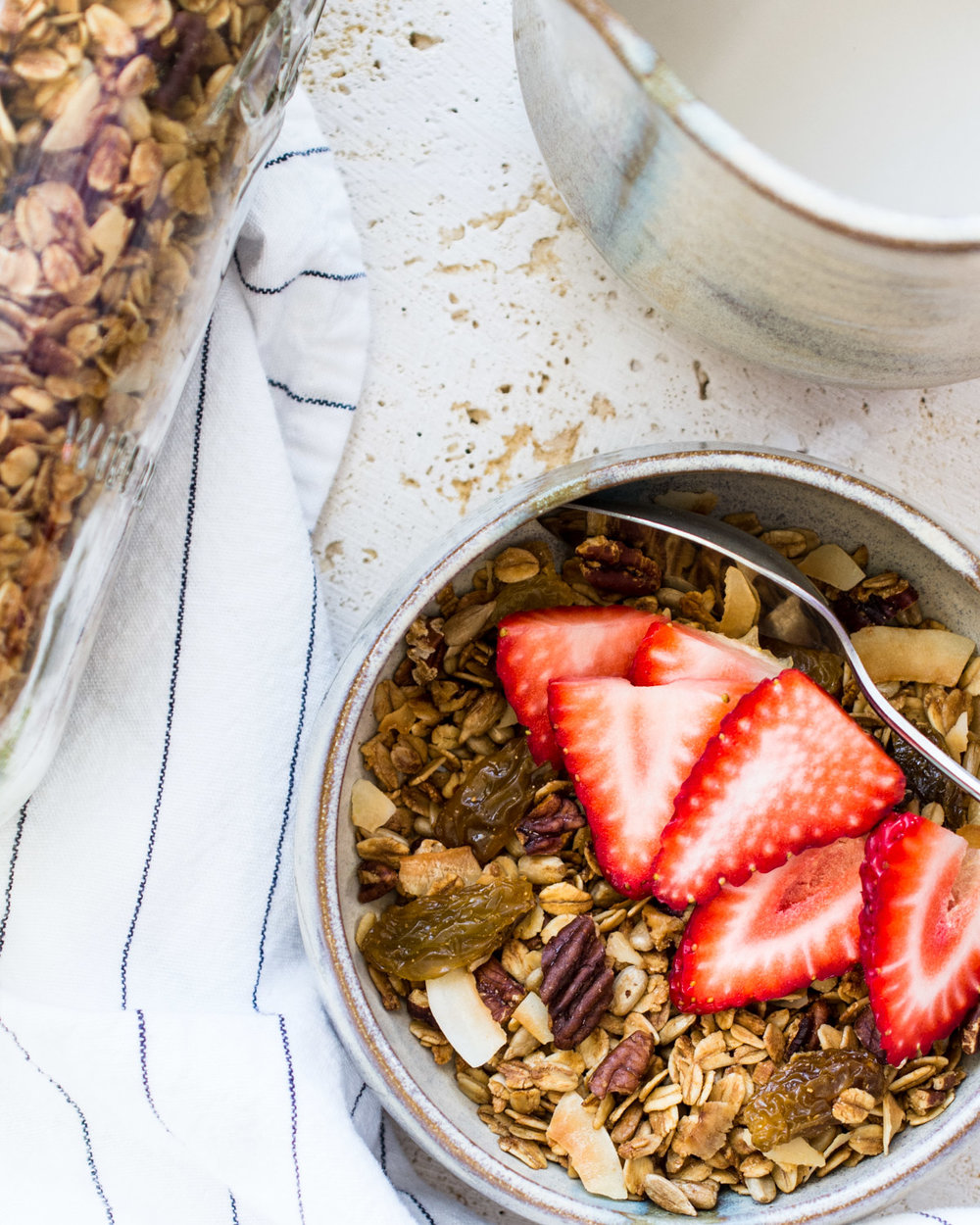 Lemon pecan granola topped with fresh California strawberries.
