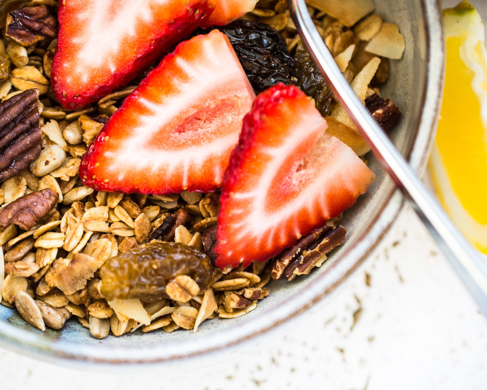 Lemon pecan granola in a bowl and ready to eat.