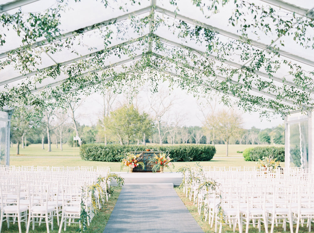 Clear+tent+with+greenery+wedding.jpeg