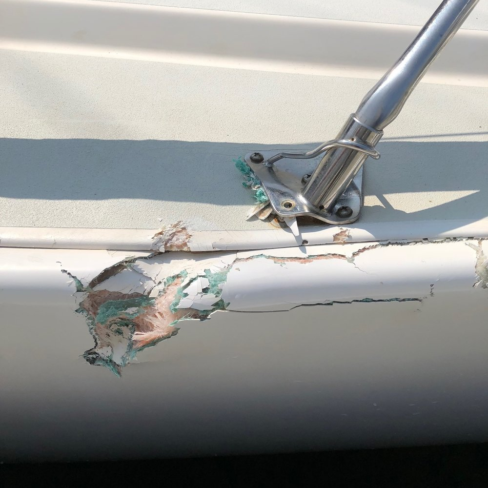 fiberglass Damage Repair - A large section of fiberglass on this J105 is cut out and replaced.