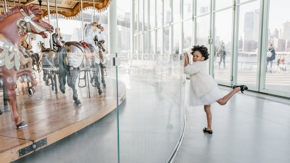 An incredible way for you to remember your child's wonderful birthday is by getting photos professionally done. This photoshoot for little Cady was help at Jane's Carousel in Brooklyn Bridge Park.