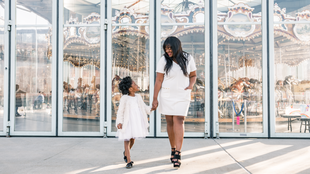 The perfect location for a fun Brooklyn Photoshoot is Jane's Carousel at Brooklyn Bridge Park.