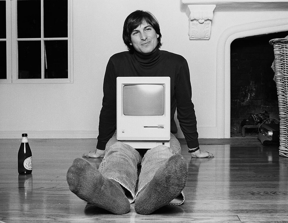 (Top) Macintosh 128k ad—1984, (Bottom) Steve Jobs with the first Mac Computer