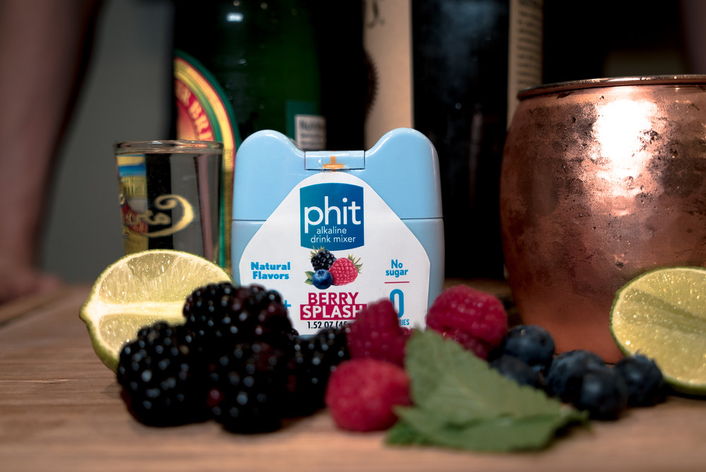 Ingredients:  Phit Berry Splash, Vodka, 1 Ginger Beer, Fresh berries, we went with raspberry blueberry and blackberry, a lime, and ice.