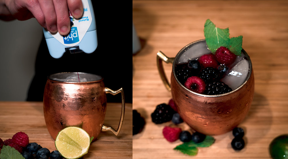 Add 2 servings of Phit Berry Splash. Then finish off your cocktail with fresh fruit and mint to really spruce up its appearance.
