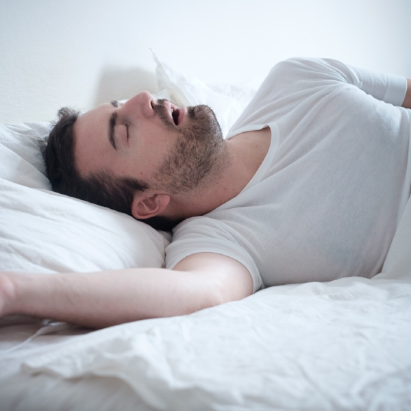 Man snoring in Bed with sleep apnea