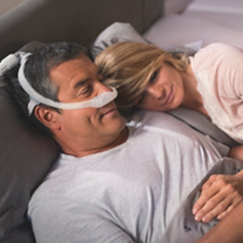 man in bed using cpap nasal mask