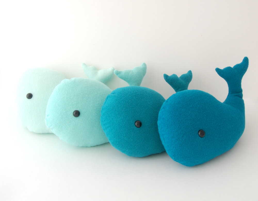 Just keep swimming... - Noah is an adorable whale friend who enjoys swimming adventures in the sea, playing with the dolphins and fish he meets along the way. Available in several shades of teal.
