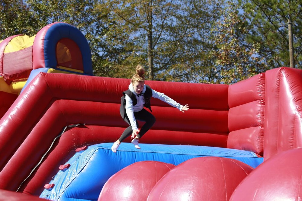Fall Festival - The annual Fall Festival is a school-wide, fun-filled event held in the fall for students, parents, teachers, and community visitors. The campus takes on a carnival atmosphere with craft booths from local artisans, advertising booths from local businesses, giant inflatables, class-sponsored game booths, and terrific concessions. Family fun is the focus of this event which promotes school spirit!