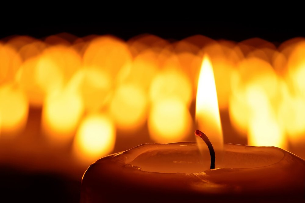 bigstock-A-Sea-Of-Candles-108290075_preview.jpeg