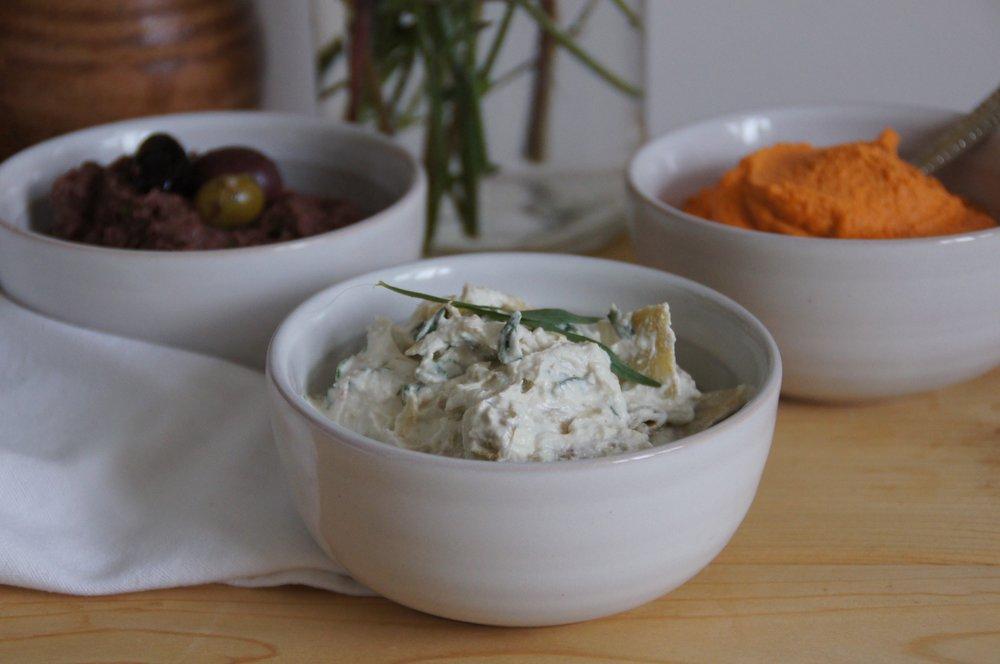 Dip trio: olive tapenade, creamy artichoke, spiced almond cheddar