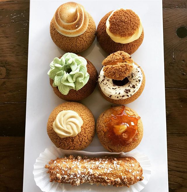 """Mango, Bailey's Chocolate, Black Forest, Earl Grey, Creme Brulee, Vanilla, Chocolate, Espresso Crumble, Salted Caramel and Vanilla Almond Croquant Eclairs.  Is today the day that you say """"Screw the diet!""""? #choux #freshlybaked #whatwedobest #newmarket #aurora #pastries #cheatday #worthit"""