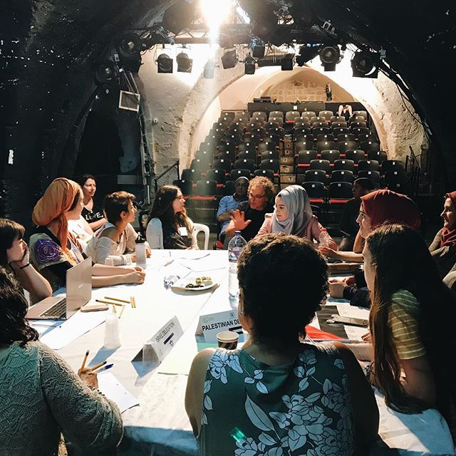 Today, the Intractable team sat in on a @mindsofpeace negotiation session between young Israeli and Palestinian women. Three tables of college students came together for a citizens' peace talk from morning until evening, breaking only briefly for lunch. Tune into Episode 7 soon to hear how it went!