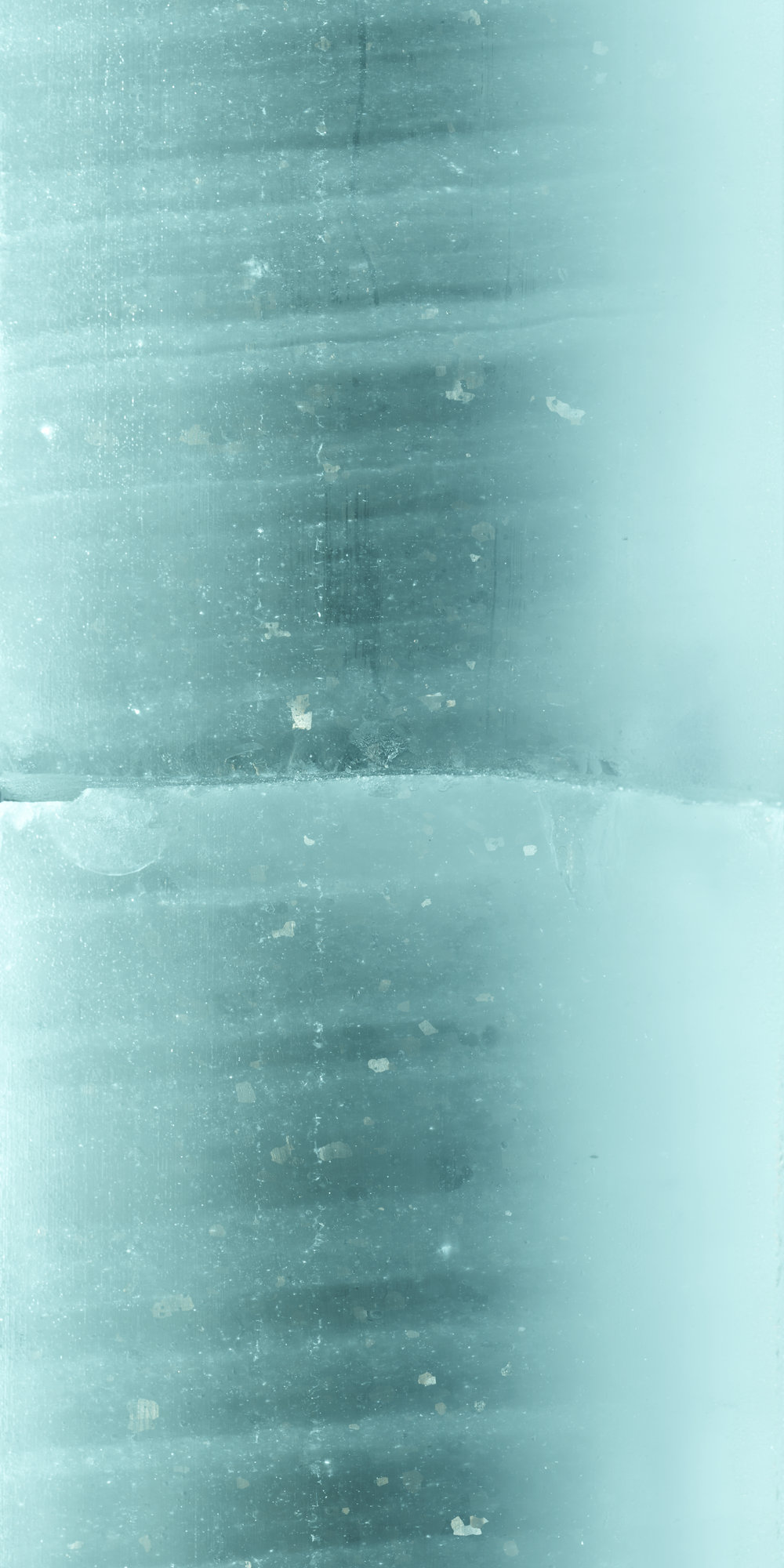 Section of an ice core from the Greenland Ice Sheet Project (GISP), taken from 2129m below the surface. Credit: Peggy Weil and the National Ice Core Laboratory.