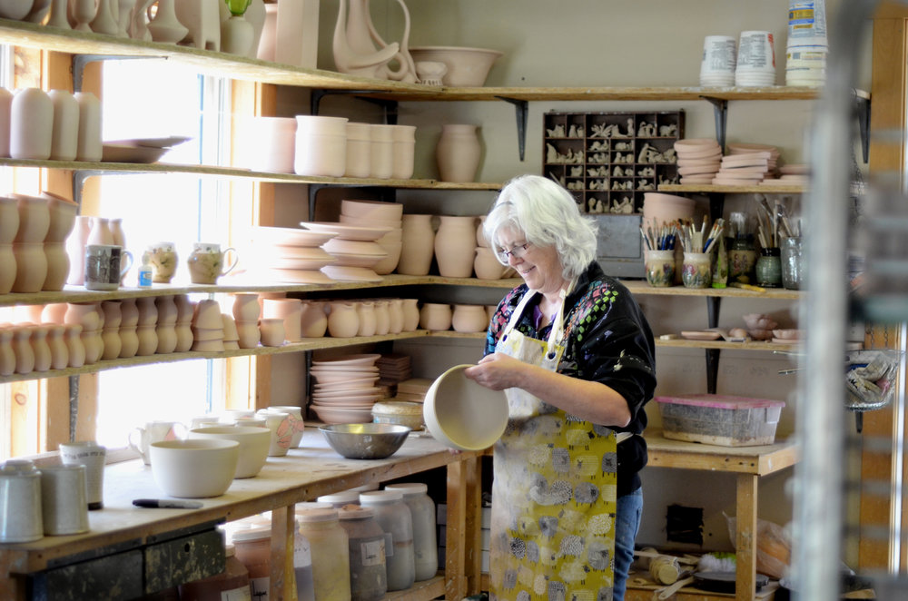 Mary Kay Decorates pottery in the studio. Image credit: Allison McKeen,
