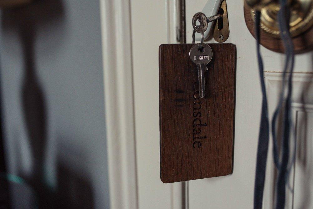 Askhma Hall room key hangs down from the door lock