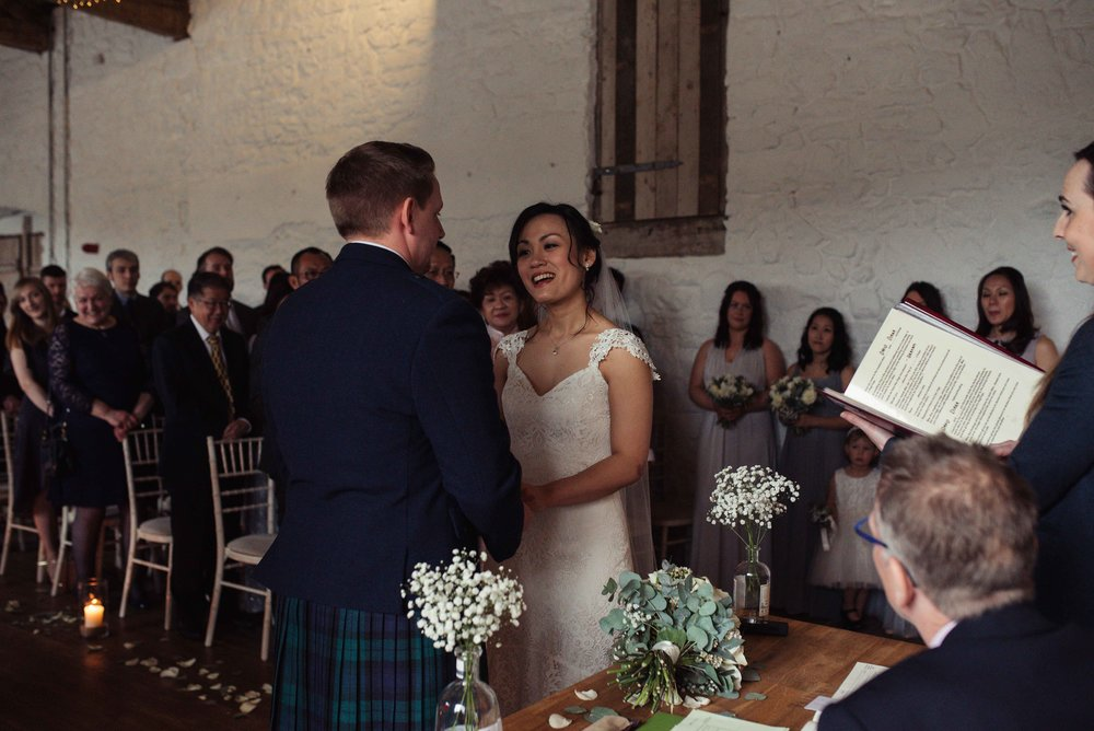 The bride and groom exchange vows during their wedding ceremony