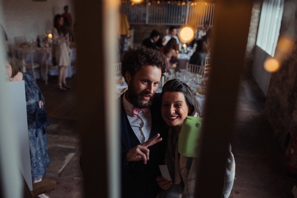 Guests take a selfie in Askham Hall wedding barn