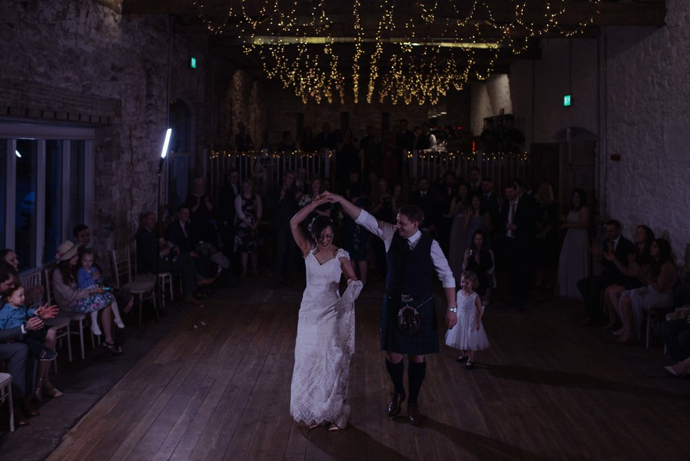 The bride and groom have their first Scottish dance