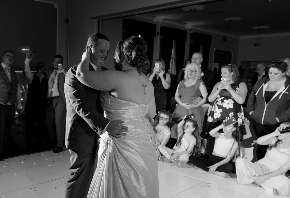 The bride and groom share their first dance together as husband and wife