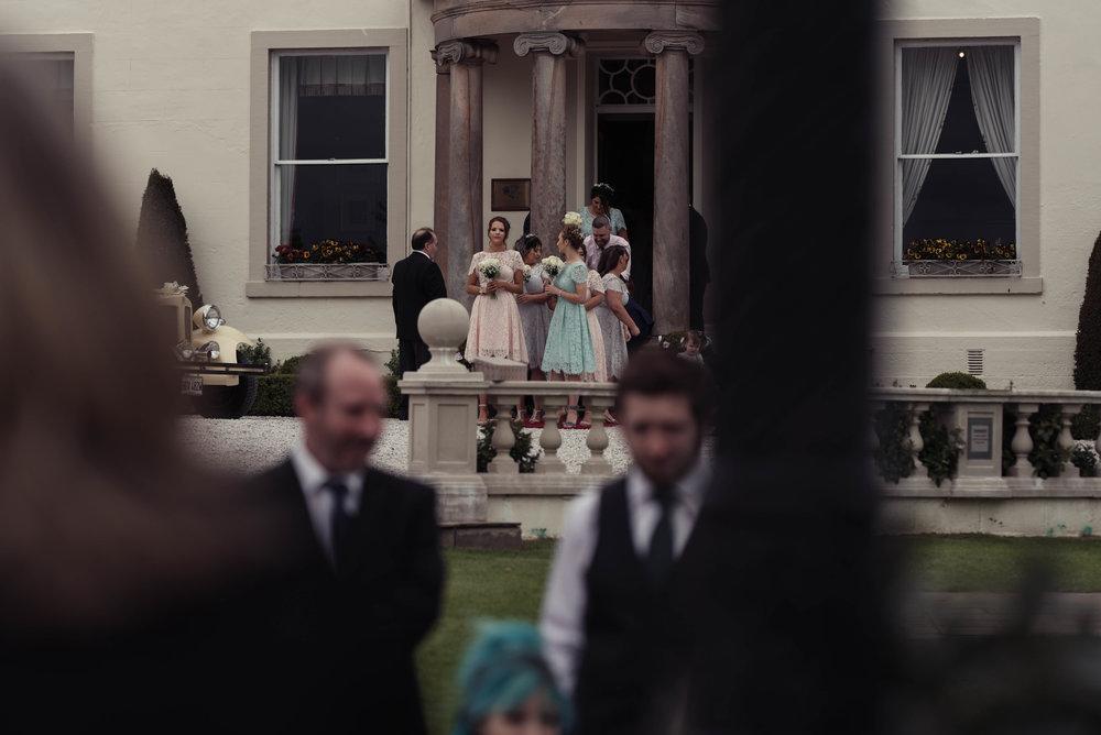 Bridesmaids gather to make their entrance to the gardens